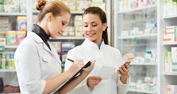 Portrait of Smiling Woman Pharmacist in Pharmacy