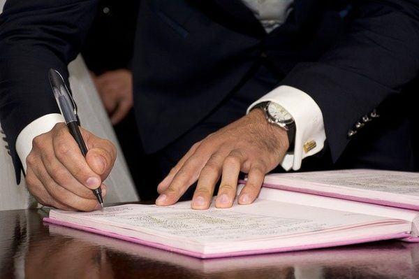 Firma en cuaderno