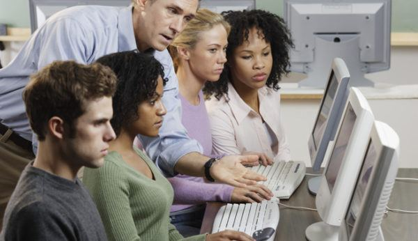 Instructor with Students in Computer Lab --- Image by © Royalty-Free/Corbis